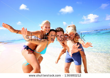 stock-photo-family-of-four-having-fun-at-the-beach-136980212